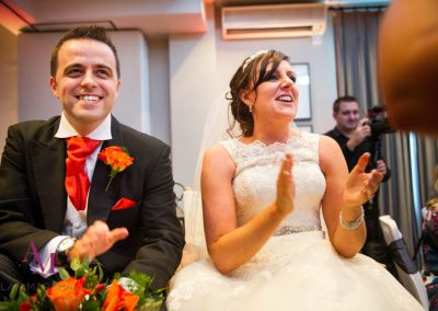Andy & Jenny watch their Fun wedding party introductuctions at Warbrook house