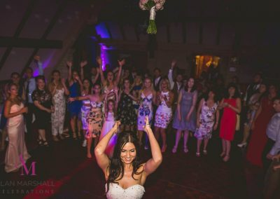 Lauren throughs her bouquet at the Manor House Hotel, Castle Combe_