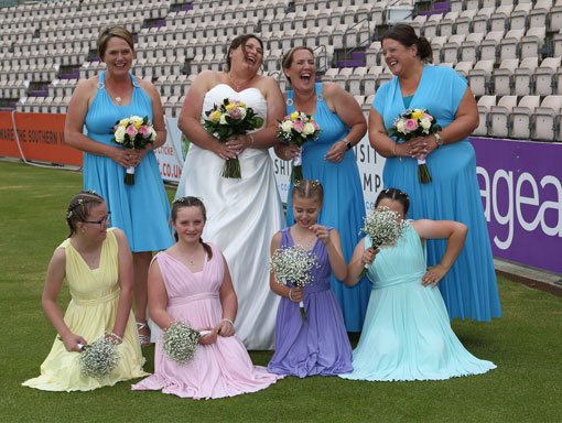 Bride-and-Bridesmaids-wedding-photo-on-the-pitch-at-the-Ageas-Bowl