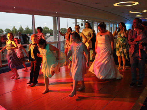 Dancing-at-a-wedding-at-the-Ageas-Bowl,-Hampshire